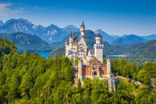 Famous Neuschwanstein Castle with scenic mountain landscape near Fssen, Bavaria, Germany